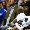 Rapper Lil Wayne says he was kicked out of the Lakers-Heat game on Sunday.