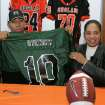 Douglass High School's Destin Stewart signs holds up a University of Hawaii jersey with his mother Sabena Watts looks on in Oklahoma City, Oklahoma February 4, 2009.  BY STEVE GOOCH, THE  OKLAHOMAN.  ORG XMIT: KOD
