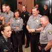 Officer Katie Lawson smiles and laughs with fellow police officers as she meets with them outside the courtroom after her shooters were sentenced to prison terms. Brothers Alex Mercado and Hector Escalante were given separate sentences by District Judge Donald Deason in an Oklahoma County courtroom Tuesday afternoon, Nov. 8, 2011 for  their involvement in shooting Oklahoma City police officer Katie Lawson during an ambush in south Oklahoma City in Aug, 2010.   Chief Bill Citty and his four assistant chiefs were seated among  nearly 40 uniformed police officers in the courtroom as the sentences were imposed. Several said they came to support Officer Lawson.  Photo by Jim Beckel, The Oklahoman