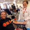 Jason Marshall (left) the Drum Major for the Pride of Oklahoma Marching Band, poses with Stephanie Donaho, of Red Cross for a faces picture during a Red Cross blood drive at the University of Oklahoma (OU) in Norman at Monday, April 6, 2009. Photo by John Clanton, The Oklahoman