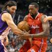 Phoenix Suns'  Luis Scola, left, battles for a rebound with Los Angeles Clippers' DeAndre Jordan during the first half of an NBA basketball game Sunday, Dec. 23, 2012, in Phoenix. (AP Photo/Ralph Freso)
