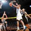 Oklahoma City's Russell Westbrook puts up a shot in front of San Antonio's George Hill and Richard Jefferson during their NBA basketball game in downtown Oklahoma City  on Sunday, Nov. 14, 2010. The Thunder lost to the Spurs 117-104. Photo by John Clanton, The Oklahoman