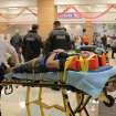 An unidentified injured person is carried to an ambulance in Granbury, Texas, on Wednesday May 15, 2013. Officials report the tornado caused