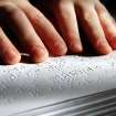 BLIND / BLINDNESS: Daniel Brookshire, a Tulsa eighth-grader, moves his fingers across words as he reads passages from one of the Braille volumes of the Bible in his family's home  on Thursday, Jan. 7, 2010. Photo by Jim Beckel, The Oklahoman ORG XMIT: KOD