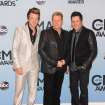 Rascal Flatts, from left, Joe Don Rooney, Gary LeVox, and Jay DeMarcus arrive at the 47th annual CMA Awards at Bridgestone Arena on Wednesday, Nov. 6, 2013, in Nashville, Tenn. (Photo by Evan Agostini/Invision/AP)