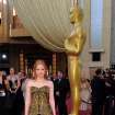 Jessica Chastain arrives before the 84th Academy Awards on Sunday, Feb. 26, 2012, in the Hollywood section of Los Angeles. (AP Photo/Chris Pizzello) ORG XMIT: OSC267