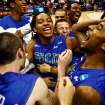 Florida Gulf Coast players celebrate after winning a third-round game against San Diego State in the NCAA college basketball tournament, Sunday, March 24, 2013, in Philadelphia. Florida Gulf Coast won 81-71. (AP Photo/Naples Daily News, Scott McIntyre) ORG XMIT: FLNAP101