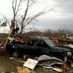 A truck stands amongst storm damage near New Pekin, Ind., on March 2, 2012. Powerful storms stretching from the U.S. Gulf Coast to the Great Lakes in the north wrecked two small towns, killed at least three people and bred anxiety across a wide swath of the country on Friday, in the second deadly tornado outbreak this week.(AP Photo/The Courier-Journal, Matt Stone) MAGS OUT; NO ARCHIVE; MANDATORY CREDIT ORG XMIT: KYLOC102