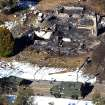 FILE - This Wednesday, Feb. 13, 2013 file photo shows an aerial view of a burned out cabin where accused quadruple-murder suspect Christopher Dorner was confirmed to have died after barricading himself inside, during a stand-off with police in Big Bear, Calif. (AP Photo/The Sun, John Valenzuela, File)