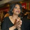 "Talk show host Oprah Winfrey arrives to the opening of the Broadway revival of ""A Raisin in the Sun"" Monday, April 26, 2004, in New York.  (AP Photo/Diane Bondareff)"