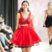 Red dress by Victoria Roberts modeled at Oklahoma Fashion Week. Photo by Gerry Hanan, Hanan Exposures   Photographer: Gerry Hanan