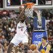Los Angeles Clippers center DeAndre Jordan (6) finishes off a slam dunk as Golden State Warriors guard Klay Thompson, right, catches the ball in the first half of an NBA basketball game in Los Angeles on Saturday, Nov. 3, 2012. (AP Photo/Richard Hartog) ,