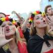 Belgium soccer fans cheer as they wait for the live telecast of the World Cup round of 16 match against the United States, inside the FIFA Fan Fest area on Copacabana beach in Rio de Janeiro, Brazil, Tuesday, July 1, 2014. (AP Photo/Leo Correa)