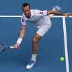 Radek Stepanek of the Czech Republic hits a forehand return to Serbia's Novak Djokovic during their third round match at the Australian Open tennis championship in Melbourne, Australia, Friday, Jan. 18, 2013. (AP Photo/Aaron Favila)