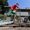 A youngster rides his scooter over a sidewalk buckled by an earthquake Sunday, Aug. 24, 2014, in Napa, Calif. A large earthquake caused significant damage and left at least three critically injured in California's northern Bay Area early Sunday, igniting fires, sending at least 87 people to a hospital, knocking out power to tens of thousands and sending residents running out of their homes in the darkness. (AP Photo/Rich Pedroncelli)