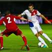 Netherland's Kenin Strootman left, and Andorra's Cristian Martinez compete for the ball during a World Cup qualification soccer match at the Communal stadium in Andorra la Vella, Andorra, Tuesday, Sept. 10, 2013. (AP Photo/Joan Manuel Baliellas)