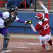 OU's Brittany Williams tries to beat the tag of LSU's Megan Blank on a suicide squeeze play during the University of Oklahoma - Louisiana State University game at