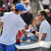 Andy Murray, left, of Great Britain, shakes hands with Flavio Cipolla, of Italy, after his 6-1, 6-3 win during their match at the Rogers Cup men's tennis tournament, Wednesday, Aug. 8, 2012, in Toronto. (AP Photo/The Canadian Press, Aaron Vincent Elkaim)
