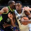 Memphis Grizzlies forward Rudy Gay, right, drives to the basket defended by Real Madrid forward Marcus Anthony Slaughter, left, in the first half of an NBA basketball preseason game on Saturday, Oct. 6, 2012, in Memphis, Tenn. (AP Photo/Nikki Boertman)