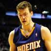 Phoenix Suns shooting guard Goran Dragic (1) walks off the court bleeding during the fourth quarter of an NBA basketball game against the Portland Trail Blazers on Wednesday, Nov. 13, 2013, in Portland, Ore. The Blazers won the game 90-89. (AP Photo/Steve Dykes)
