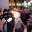 Nancy Levindowski and Steve Keller kiss after exchanging wedding vows at the Denny's restaurant on Fremont Street in Las Vegas, Wednesday, April 4, 2013. (AP Photo/Las Vegas Sun, Sam Morris)