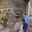 Bob Shull with Teen Pottery Throwing student at the Firehouse Art Center checking to see if his pots are dry enough to trim. This class meets Thursdays after school until 6:30pm. For more information please call 405-329-4523 or visit the website at http://www.normanfirehouse.com  Community Photo By:  Lana Leigh Wilkens  Submitted By:  Danette, Norman