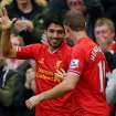 Liverpool's Luis Suarez, left, celebrates scoring his and Liverpool's third goal of the game during the English Premier League soccer match against West Bromwich Albion at Anfield, Liverpool, England, Saturday, Oct. 26, 2013. (AP Photo/Dave Thompson, PA Wire)  UNITED KINGDOM OUT  -  NO SALES  -  NO ARCHIVES