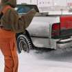A man helps the driver of this truck get unstuck in the parking lot of a convenience store near SE 15 and Post Rd. in Midwest City. A winter storm created whiteout conditions and caused snow drifts that made problems for the few motorists who ventured out Tuesday morning, Feb. 1, 2011.   Photo by Jim Beckel, The Oklahoman