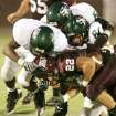 Memorial's Anthony Morales (22) is tackled by Santa Fe's, from left, Tim Johnson, Johnathan Allen and Trevor Pletcher in the second quarter during the high school football game between Edmond Memorial and Edmond Sante Fe at Wantland Stadium in Edmond, Okla., Friday, Sept. 12, 2008. BY MATT STRASEN, THE OKLAHOMAN