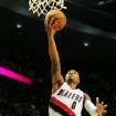 Portland Trail Blazers point guard Damian Lillard (0) drives to the basket past Phoenix Suns small forward P.J. Tucker (17) to score the winning basket late in the fourth quarter of an NBA basketball game on Wednesday, Nov. 13, 2013, in Portland, Ore. The Blazers won the game 90-89. (AP Photo/Steve Dykes)