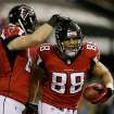 Atlanta Falcons' Tony Gonzalez (88) is congratulated by Michael Palmer after his 10-yard touchdown catch during the first half of the NFL football NFC Championship game against the San Francisco 49ers Sunday, Jan. 20, 2013, in Atlanta. (AP Photo/David Goldman)
