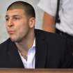 Former New England Patriot football player Aaron Hernandez, listens to procedings in a court in Attleboro, Mass., Thursday, Aug. 22, 2013. Hernandez was indicted on first-degree murder and weapons charges in the death of a friend whose bullet-riddled body was found in an industrial park about a mile from the ex-player's home. (AP Photo/Josh Reynolds)