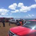 This photo provided by Kauai County shows emergency response vehicles near the site of a plane crash in Hanapepe, Hawaii, on Monday, May 23, 2016. All five people aboard a small plane died in a fiery crash on Kauai, officials said. (Sarah Blane/Kauai County via AP)