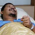 Thai man bloodied but unbowed after intimate...
