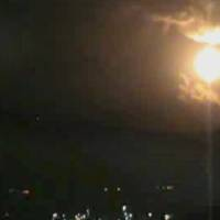 Photo - In this image taken from video obtained from the Ugarit News, which has been authenticated based on its contents and other AP reporting, a Israeli airstrikes hit Damascus, Syria, early Sunday, May 5, 2013. Israeli warplanes struck areas in and around the Syrian capital Sunday, setting off a series of explosions as they targeted a shipment of highly accurate, Iranian-made guided missiles believed to be on their way to Lebanon's Hezbollah militant group, officials and activists said. The attack, the second in three days, signaled a sharp escalation of Israel's involvement in Syria's bloody civil war. Syria's state media reported that Israeli missiles struck a military and scientific research center near the Syrian capital and caused casualties. (AP Photo/Ugarit News via AP video)