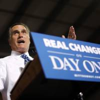 Photo -   Republican presidential candidate, former Massachusetts Gov. Mitt Romney gestures as he campaigns at Screen Machine Industries, in Etna, Ohio, Friday, Nov. 2, 2012. (AP Photo/Charles Dharapak)