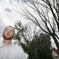 Photo - Ryan Ochsner, urban forestry coordinator in Edmond, with a Silver Maple that is 80 percent dead, Friday, June 1, 2012. Trees have been weakened by the drought in 2011. Photo By David McDaniel/The Oklahoman