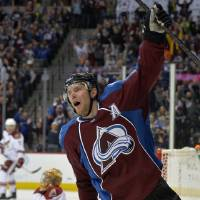 Photo - Colorado Avalanche center Paul Stastny celebrates a goal against Phoenix Coyotes goalie Thomas Greiss during the third period of an NHL hockey game on Friday, Feb. 28, 2014, in Denver. (AP Photo/Jack Dempsey)