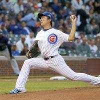 Photo - Chicago Cubs starting pitcher Tsuyoshi Wada delivers during the first inning of a baseball game against the Colorado Rockies Monday, July 28, 2014, in Chicago. (AP Photo/Charles Rex Arbogast)