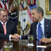"Photo - FILE - This Nov. 16, 2012 file photo shows President Barack Obama shaking hands with House Speaker John Boehner of Ohio in the Roosevelt Room of the White House in Washington, during a meeting to discuss the deficit and economy. Congress and the White House can significantly soften the initial impact of the ""fiscal cliff"" even if they fail to reach a compromise by Dec. 31. One thing they cannot control, however, is the financial markets' reaction, which possibly could be a panicky sell-off that triggers economic reversals worldwide. The stock market's unpredictability is perhaps the biggest wild card in the political showdown over the fiscal cliff.  (AP Photo/Carolyn Kaster, File)"