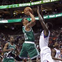 Photo - Boston Celtics' Courtney Lee (11) shoots as Philadelphia 76ers' Royal Ivey  defends in the first half of an NBA basketball game, Tuesday, March 5, 2013, in Philadelphia. (AP Photo/H. Rumph Jr)