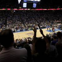 Photo - OVERVIEW: Fans cheer at the beginning of the NBA basketball game between the Miami Heat and the Oklahoma City Thunder at Chesapeake Energy Arena in Oklahoma City, Sunday, March 25, 2012. Photo by Nate Billings, The Oklahoman