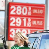Photo - Suzanne Busby fills up her car's tank with gasoline Monday at 7-Eleven at NW 39 and Tulsa in Oklahoma City.  Photo By Steve Gooch, The Oklahoman