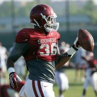 Photo - Fullback Dimitri Flowers (36) goes through drills during the University of Oklahoma Sooners (OU) football practice at the rugby fields in Norman, Okla., on Tuesday, Aug. 5, 2014. Photo by Steve Sisney, The Oklahoman