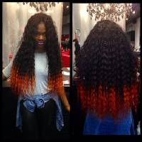 Photo - In this undated image provided by Miranda Jade Plater and posted in April 2014 to the Instagram account of her company, Limelight Extensions, Plater poses wearing long, black curly hair extensions with the ends dyed bright orange at her salon in Farmington Hills, Mich. This photo alone has generated about $10,000 in sales. (AP Photo/Courtesy Miranda Jade Plater)