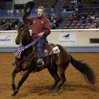 Photo - Corey Cushing, of Scottsdale, Ariz., rides Rising Starlight on Saturday during the American Quarter Horse Association World  Championship Show.  Photo by Garett Fisbeck, The Oklahoman
