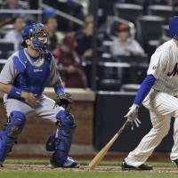 Photo - New York Mets' Jonathon Niese follows through on a double to center field against the Los Angeles Dodgers during the fifth inning of a baseball game, Thursday, May 22, 2014, in New York. (AP Photo/Julie Jacobson)