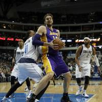 Photo - Dallas Mavericks' Shawn Marion (0) defends against a move to the basket by Los Angeles Lakers' Pau Gasol (16) of Spain as Vince Carter (25) and Monta Ellis, left rear, watch in the first half of an NBA basketball game, Tuesday, Jan. 7, 2014, in Dallas. (AP Photo/Tony Gutierrez)