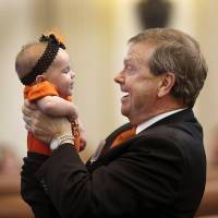 Photo - Rep. Brian Renegar, Dist. 17, plays with his granddaughter on the floor of the House. Newly elected Oklahoma  lawmakers were sworn in by Supreme Court Chief Justice Steven Taylor during separate separate ceremonies in their respective chambers at the State Capitol Wednesday, Nov. 14, 2012.  Photo by Jim Beckel, The Oklahoman