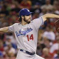 Photo - Los Angeles Dodgers starting pitcher Dan Haren throws against the Los Angeles Angels during the sixth inning of a baseball game on Wednesday, Aug. 6, 2014, in Anaheim, Calif. (AP Photo/Jae C. Hong)